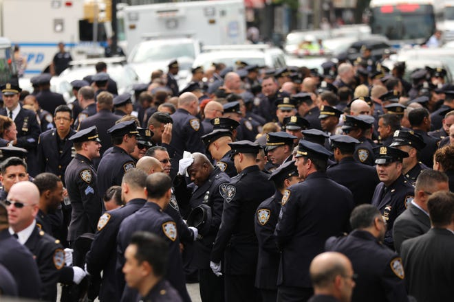 Hundreds of police officers and firefighters attend the funeral for retired NYPD detective Luis Alvarez on July 03, 2019 in the Queens borough of New York City.