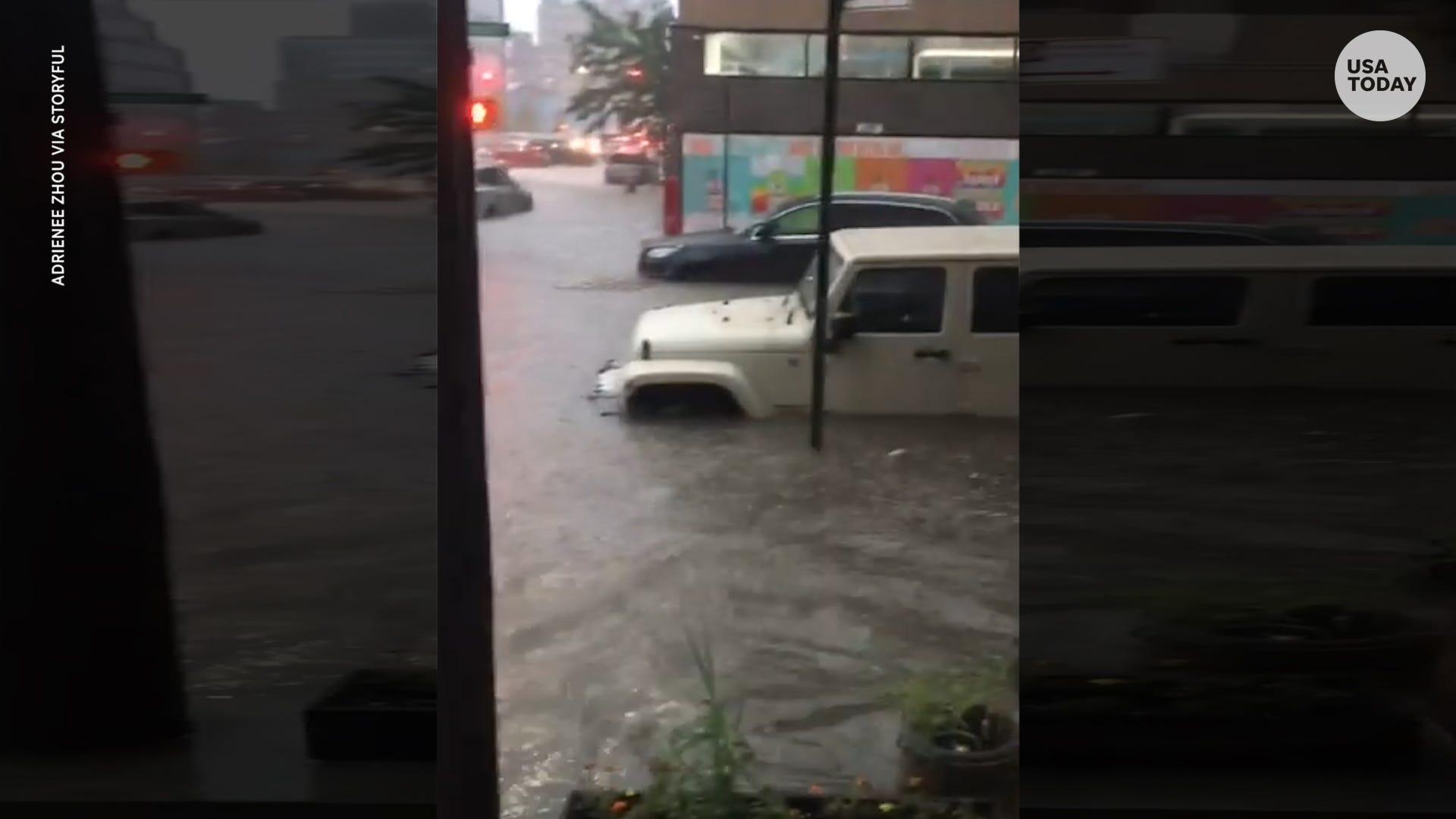 Knee-deep rain floods Brooklyn street