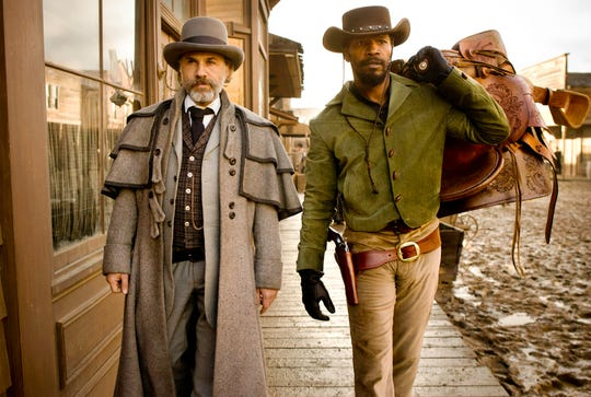 "Christoph Waltz (left) and Jamie Foxx are an unlikely duo on a mission of revenge in ""Django Unchained."""