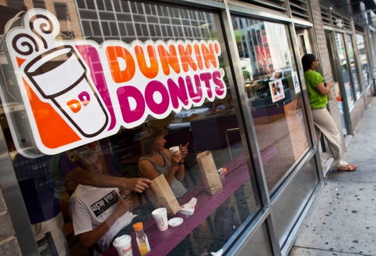 A customer exits a Dunkin' Donuts store in midtown Manhattan on July 11, 2011 in the New York City.