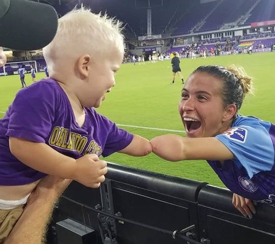 Joseph Tidd meets role model soccer player Carson Pickett.
