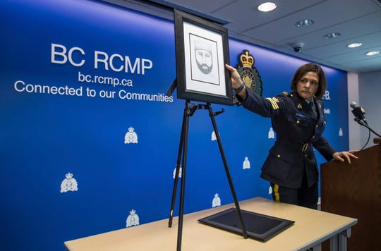 Royal Canadian Mounted Police Sgt. Janelle Shoihet points to a sketch of a man whom the RCMP say interacted with Lucas Fowler and Chynna Deese during a news conference in Surrey, British Columbia, on July 22, 2019.