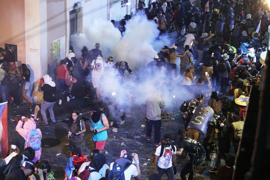 Police clash with protesters as they show against Gov. Ricardo Rossello on July 22, 2019, in Mature San Juan, Puerto Rico.