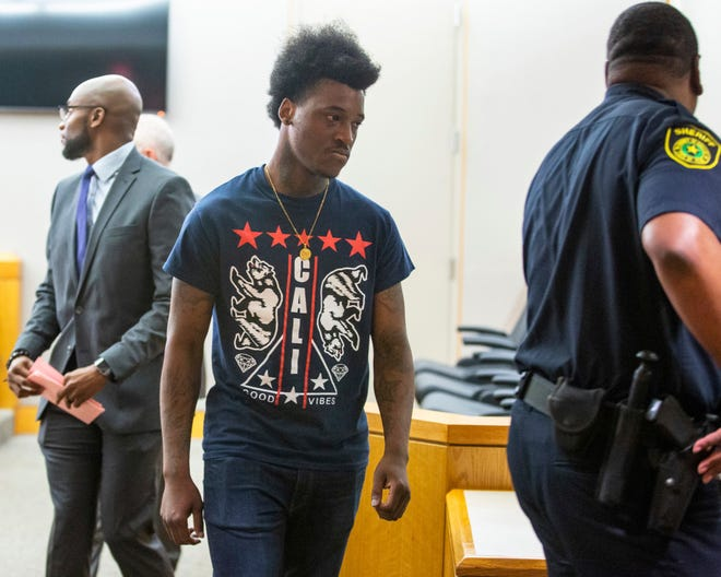 Sidney Gilstrap-Portley, 26, leaves the 291st District Court after pleading guilty to three felony charges of tampering with a government record and one charge of indecency with a child at the Frank Crowley Courts building in Dallas, on Tuesday, July 23, 2019. Gilstrap-Portley posed as a 17-year-old Hillcrest High School student when he was 25. (Lynda M. Gonzalez/The Dallas Morning News via AP)