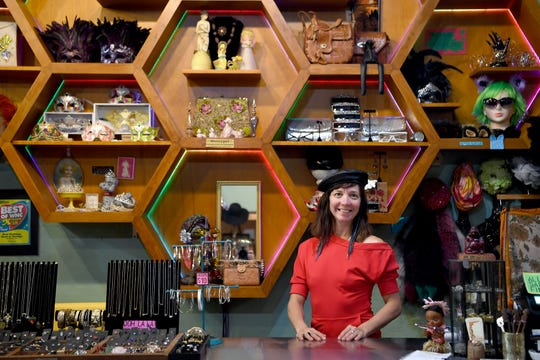"Sara Legatski, owner of Honeypot Vintage Emporium in downtown Asheville, poses in a 1980s look from her store on July 24, 2019. Legatski sold about 300 pieces of clothing to outfit the cast and extras on the latest season of the Netflix show ""Stranger Things"" which is set in the summer of 1985."