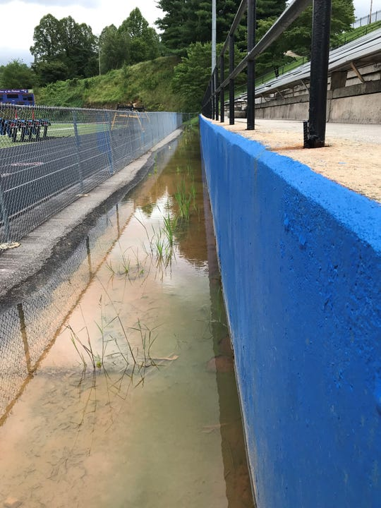Reports from engineers cited concerns with water seepage and a rotating retaining wall as reasons to block off seating at the eastern edge of the Madison High School stadium.