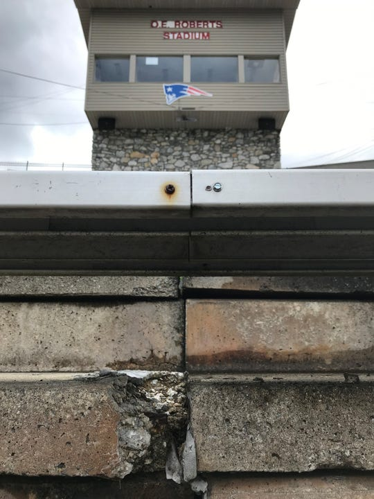 """Cracked concrete at O.E Roberts Stadium, built in 1972, is a sign of the facility's """"distress/deterioration,"""" according to an engineer's report."""