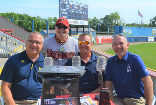 Former Detroit Tiger Brandon Inge, center, sits down with Scott Salow, right, Tom Salow, left, and Jim Smith, standing, at C.O. Brown Stadium for a Facebook Live event to promote Dingers for DIPG.