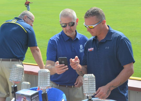 Former Detroit Tiger Brandon Inge talks to Homer baseball coach Scott Salow prior to a promotion event to showcase the upcoming Dingers for DIPG at C.O. Brown Stadium.