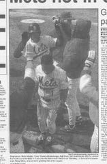 Omar Garcia, back, high-fiving teammates after scoring a run in the 1994 season opener, which the B-Mets won, 4-1.