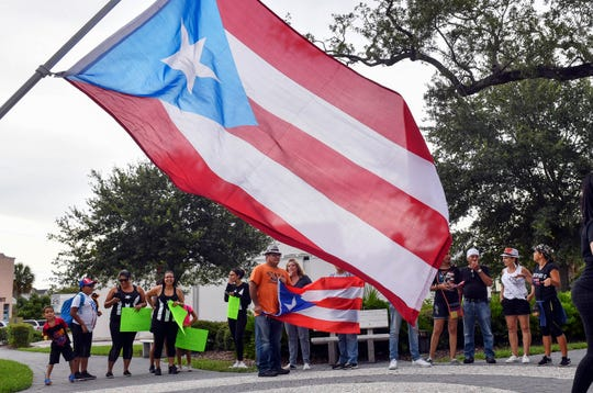 People gathered Tuesday in Eau Gallie Square Park to protest against corruption in Puerto Rico and to demand the resignation of its governor. Governor Ricardo Rossello announced his resignation late Wednesday.