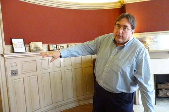 Thomas Palmer points out architectural features of the Gill House in Galion, which will be the site of a celebration of Henry Ford's birthday this Saturday.