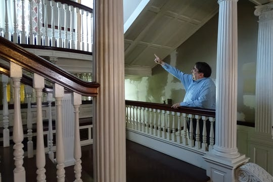 Thomas Palmer points out architectural features of the Gill House in Galion, which will be the site of a celebration of Henry Ford's birthday this Saturday, the  156th anniversary of his birth.