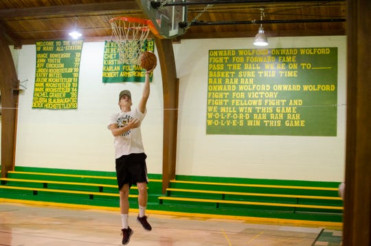 Cole Slaubaugh, a rising junior in high school, shoots hoops in the gymnasium at Wolford Public School on July 24, 2019.