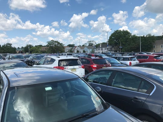 The parking lot at Haddonfield's PATCO station was packed Wednesday as commuters coped with the second day of limited service. The Ashland and Lindenwold stations were shut down Monday evening after a large tree fell on the tracks, smashing a utility pole that had supplied power to the stations.