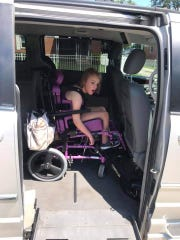 Hannah Owens sits in her new van after the zumba fundraiser on Saturday, July 20, 2019.
