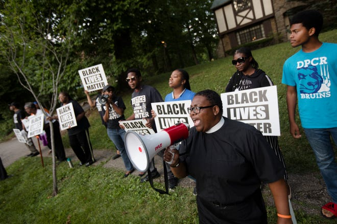 Pastor Lesley Jones leads protestors in chants while protesting the imprisonment of Tracie Hunter, a former juvenile court judge, on Clifton Avenue in Clifton on Tuesday, July 23, 2019.