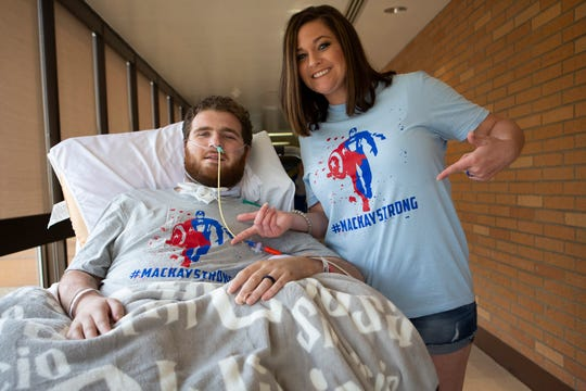 Chris Mackay and Ashley Mackay pose for a portrait at St. Elizabeth Hospital in Fort Thomas, Kentucky, on Tuesday, July 23, 2019. On May 18, 2019, Chris got into a severe accident where he broke the C5 spine vertebra in his neck. Chris was planning to propose to Ashley in July, but the unexpected accident changed their plans. On May 21, before Chris was taken into surgery, the couple decided to get married in the hospital.