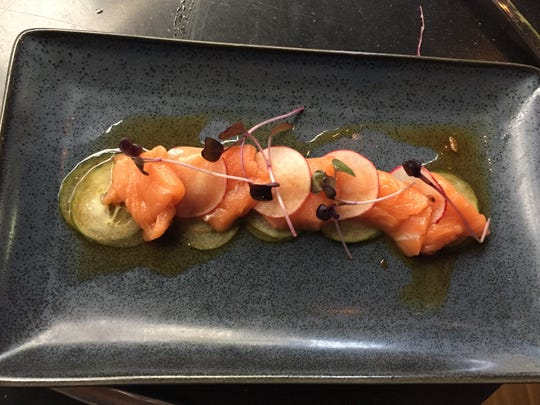 Salmon sashimi with pickled cucumber, radish and sweet ponzu sauce from Kaze in Over-the-Rhine, now owned by Thunderdome group