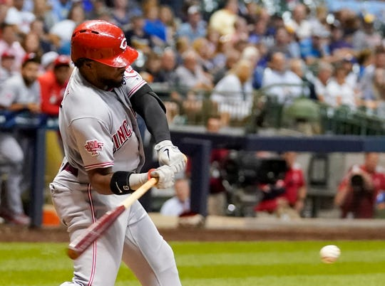Cincinnati Reds' Phillip Ervin hits a three-run scoring triple during the fifth inning of a baseball game against the Milwaukee Brewers Tuesday, July 23, 2019, in Milwaukee.