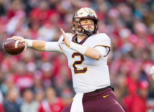 Nov 24, 2018; Madison, WI, USA; Minnesota Golden Gophers quarterback Tanner Morgan (2) throws a pass during the first quarter against the Wisconsin Badgers at Camp Randall Stadium.