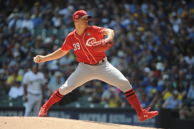 Jul 24, 2019; Milwaukee, WI, USA; Cincinnati Reds starting pitcher Lucas Sims (39) delivers a pitch against the Milwaukee Brewers at Miller Park. Mandatory Credit: Michael McLoone-USA TODAY Sports