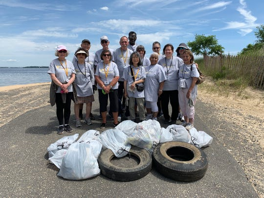 Volunteers from Old Bridge's Silver Linings Clean Communities are shown here cleaning up the Laurence Harbor area.