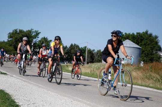 Cyclists make their way along the route during RAGBRAI on Tuesday, July 23, 2019.