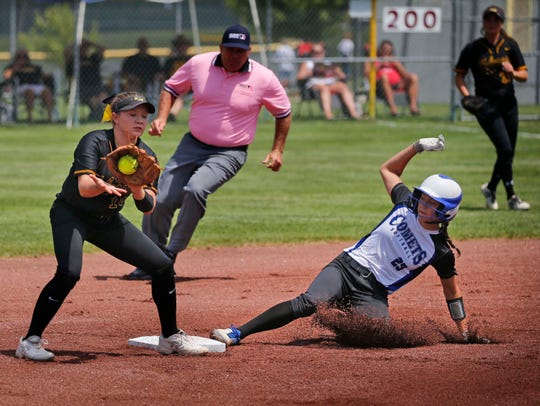 Katie Koppe of Louisa-Muscatine tries to tag Austyn Crees of West Liberty as she slides into second in the State Semifinal game against Wednesday, July 24, 2019.