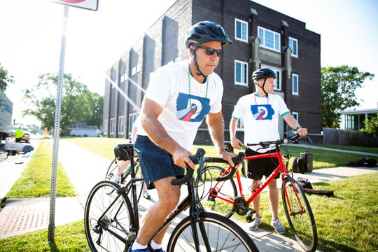 Maryland Representative and 2020 Democratic presidential candidate John Delaney pushes off to ride a few miles of RAGBRAI from Indianola to Liberty Center on Wednesday, July 24, 2019.