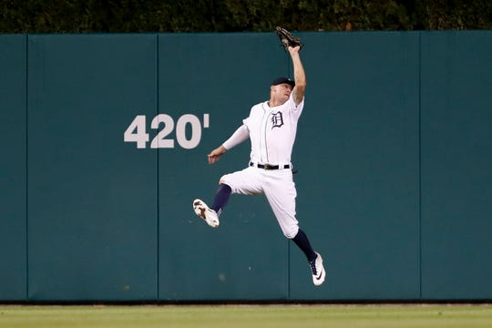 Tigers center fielder JaCoby Jones makes a jumping catch for an out during the 12th inning of the Tigers' 3-2 loss to the Phillies on Tuesday, July 24, 2019, at Comerica Park.