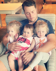 Lions quarterback Matthew Stafford in a photo with his three daughters, Chandler, Hunter and Sawyer.