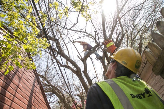 DTE Energy workers repair lines on Wednesday April 26, 2017 in a neighborhood on Detroit's east side.