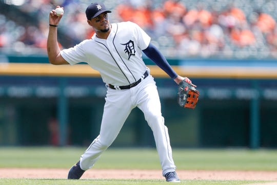 Detroit Tigers third baseman Jeimer Candelario makes a throw to first base for an out during the second inning against the Philadelphia Phillies at Comerica Park, July 24, 2019.