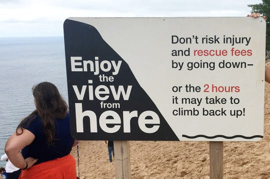A sign at Sleeping Bear Dunes National Lakeshore in Michigan warns visitors about the risks of climbing the dunes.