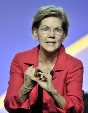 Presidential candidate Sen. Elizabeth Warren addresses the crowd at the NAACP convention Wednesday.