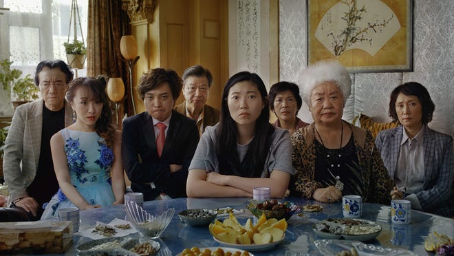 "Awkwafina, center, in ""The Farewell."""