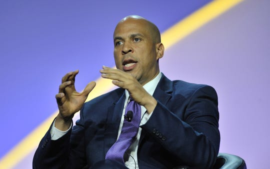Presidential candidate Sen. Corey Booker speaks Wednesday at the NAACP national convention in Detroit.