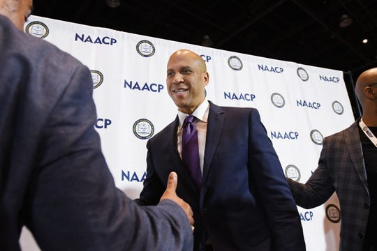 Democratic presidential candidate Cory Booker answers questions from media during a visit to the NAACP convention at Cobo Center in Detroit.