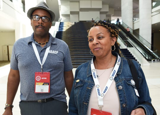 Ralph Martin, left, and Lisa Coney, both of Saginaw, talk about their experiences at the NAACP convention at Cobo Center in Detroit on Wednesday.