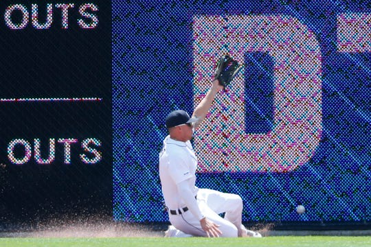 Tigers center fielder JaCoby Jones can't reach a fly ball hit by Phillies' Rhys Hoskins in the first inning of Wednesday's 4-0 loss.