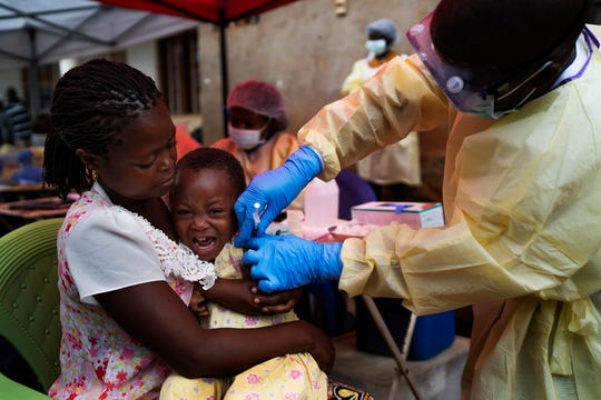 In this Saturday, July 13, 2019 photo, a child is vaccinated against Ebola in Beni, Congo. Health experts agree the experimental Ebola vaccine has saved multitudes in Congo. But after nearly a year and some 171,000 doses given, the epidemic shows few signs of waning.