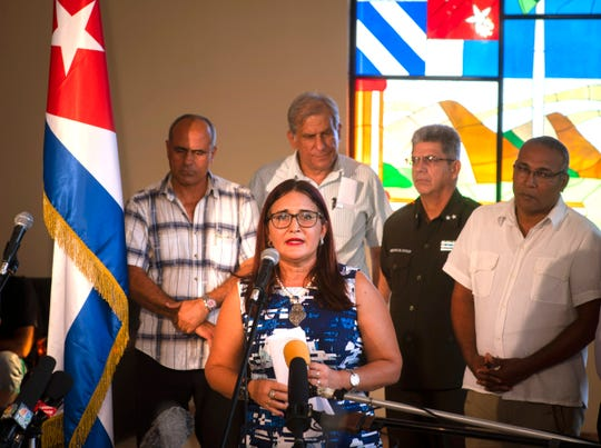 Deputy Director for the United States division of the Cuban Ministry of Foreign Affairs Johana Tablada speaks to reporters in Havana, Cuba, Tuesday, July 23, 2019. Advanced brain scans found perplexing differences in U.S. diplomats who say they developed concussion-like symptoms after working in Cuba, a finding that only heightens the mystery of what may have happened to them, a new study says. (AP Photo/Ramon Espinosa )