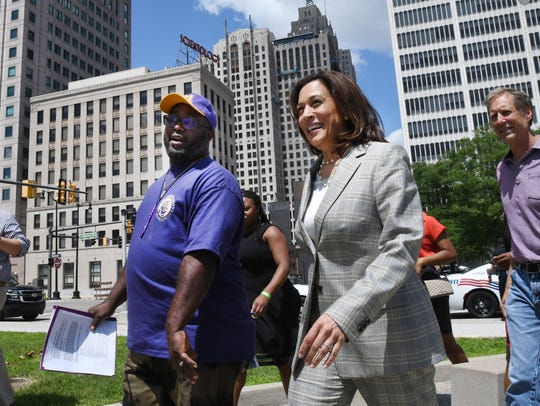 Marty Woods, a SEIU Local 1 janitor, escorts Democratic presidential candidate Sen. Kamala Harris to the SEIU Local 1 rally in Hart Plaza Wednesday.