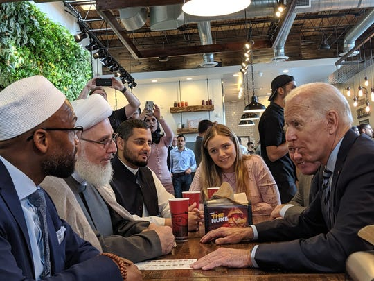 Former Vice President Joe Biden, right, talks on Wednesday (July 24, 2019) with Mika'il Stewart Saadiq of the Michigan Muslim Community Council, Sheikh Ahmed Hammoud of the Islamic Center of America and Shaykh Mohamad Almasmari of the Muslim Unity Center.