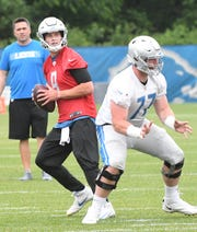 Lions quarterback Matthew Stafford, left, has spent the early portion of offseason workouts with Frank Ragnow at center.