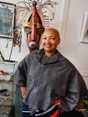 Mandisa Smith of Detroit Fiber Works wears her silk and wool Nuno felted poncho.