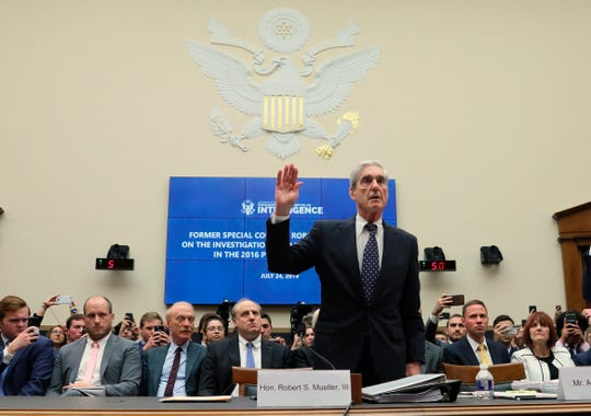 Former special counsel Robert Mueller is sworn in to testify before a House Intelligence Committee hearing on Russian Interference in the 2016 presidential election on Capitol Hill in Washington, Wednesday, July 24, 2019.