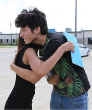 U.S. citizen Francisco Galicia, right, 18, gets a hug from his attorney, Claudia Galan, after his release.