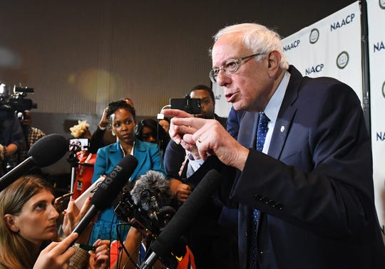 Democratic presidential candidate Bernie Sanders answers questions from media during a visit to the NAACP convention at Cobo Center in Detroit.